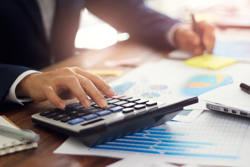 Businessman using calculator to calculate budget, Payments, Business financing and accounting banking concept royalty free stock photography