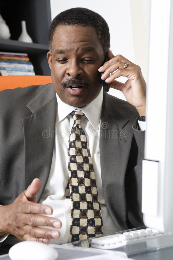 Download Businessman Using Cell Phone Stock Photos - Image: 29660903