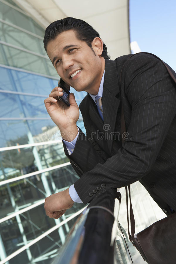 Businessman Using Cell Phone Outside Office royalty free stock images