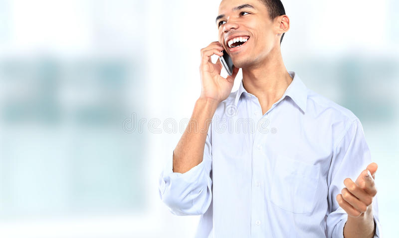 Businessman using a cell phone. Portrait of a businessman using a cell phone stock photography