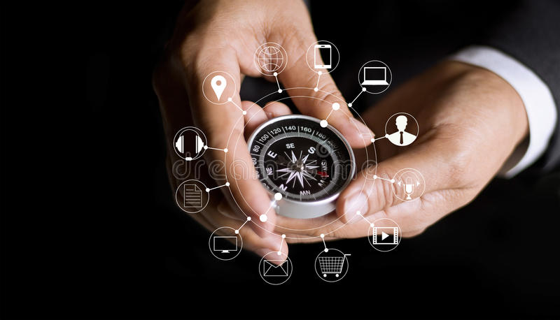Businessman using compass finding online shopping royalty free stock photo