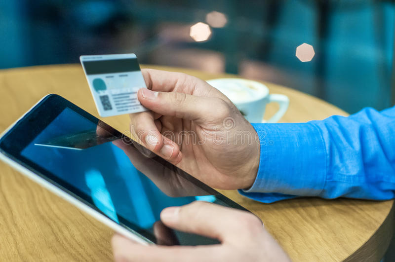 Businessman using a credit card and digital tablet for buying on internet. Businessman using a credit card and digital tablet for buying on-line. Man buying on royalty free stock photography