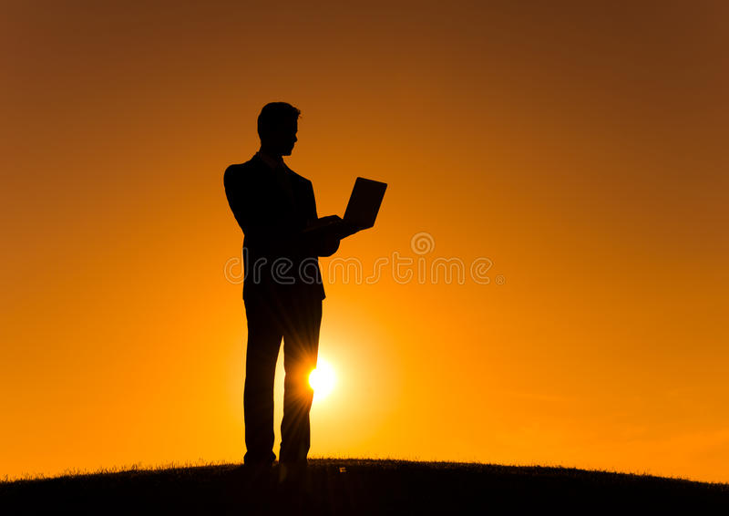 Businessman Using Digital Devices on the Hill royalty free stock images