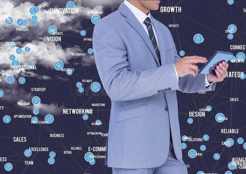 Businessman using digital tablet against cloud computing icons. Mid section of businessman using digital tablet against cloud computing icons stock photography