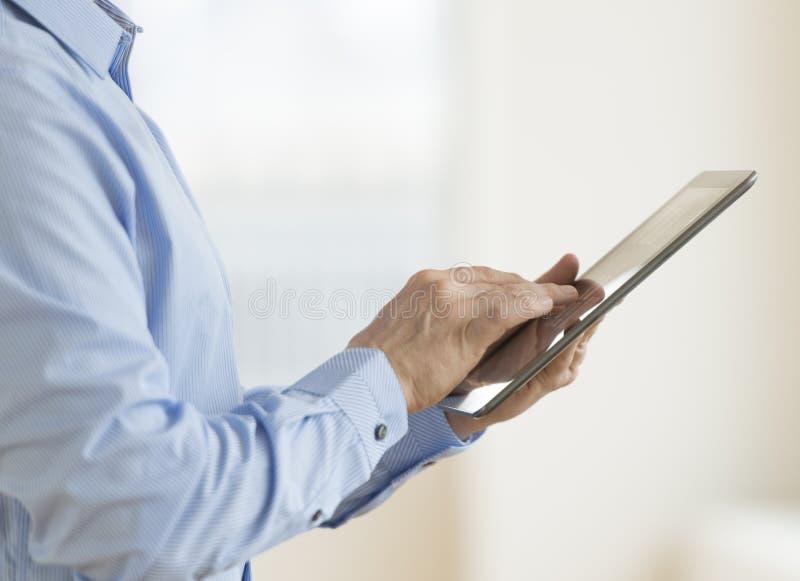 Download Businessman Using Digital Tablet Stock Photo - Image: 32062358