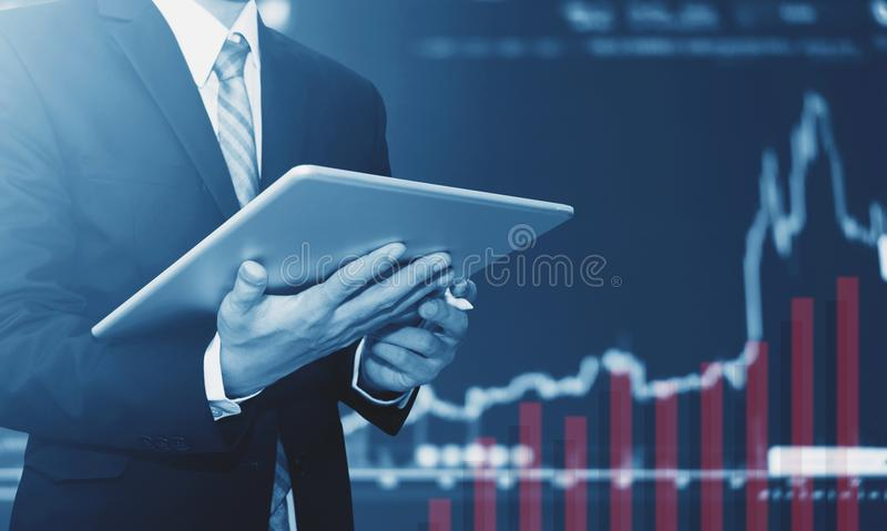 Businessman using digital tablet, raising graph background. Business growth royalty free stock photos