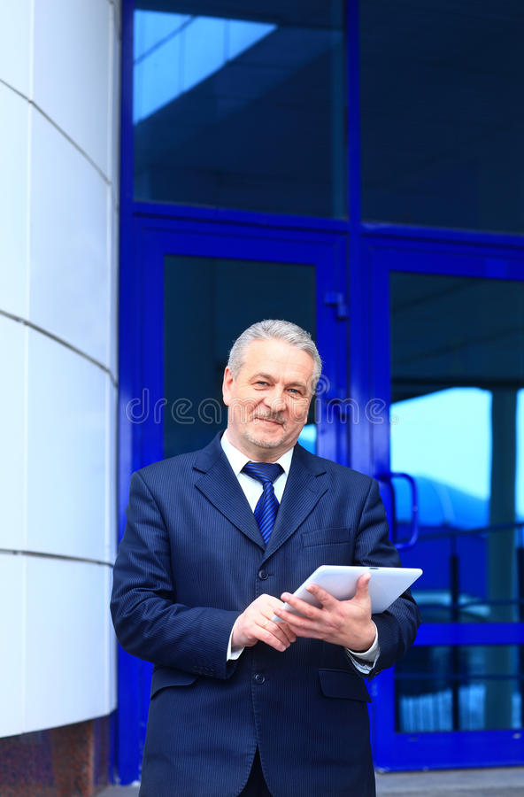 Free Businessman Using His Digital Tablet Royalty Free Stock Image - 30272666