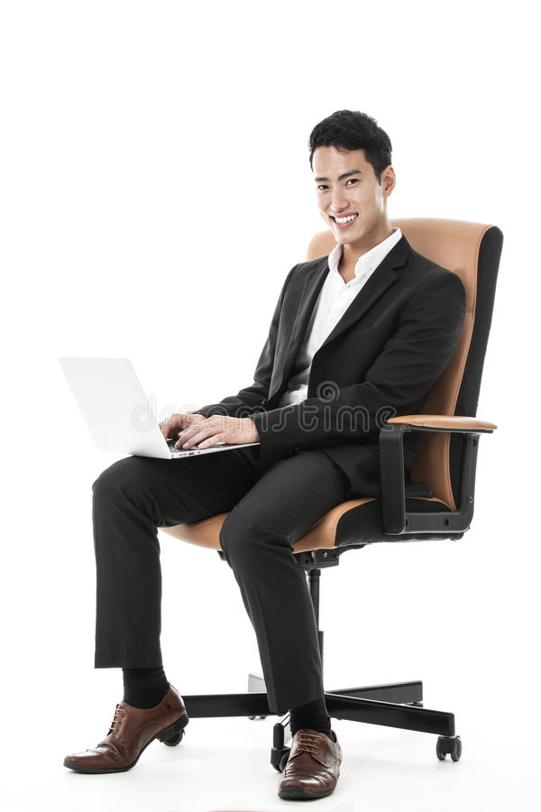 Download Businessman Using His Laptop Royalty Free Stock Photo - Image: 36707435