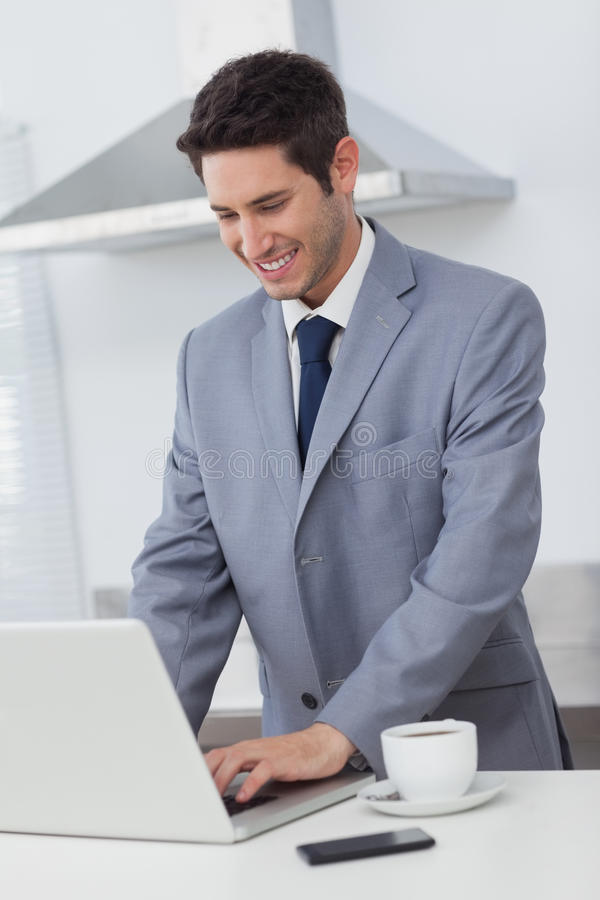 Download Businessman Using His Laptop While Having Breakfast Stock Image - Image of dressed, using: 32232589