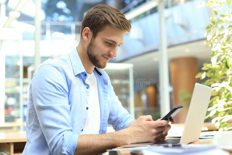 Businessman using his mobile phone in the office royalty free stock photo