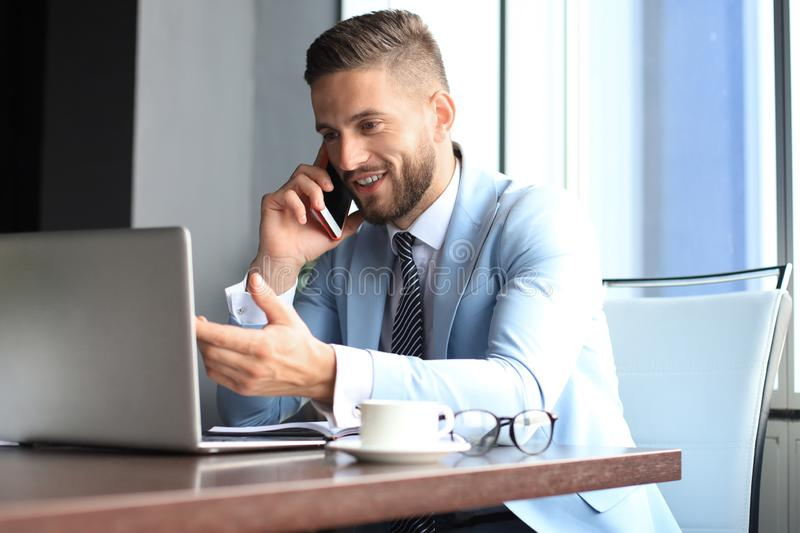Businessman using his mobile phone in the office.  royalty free stock photos