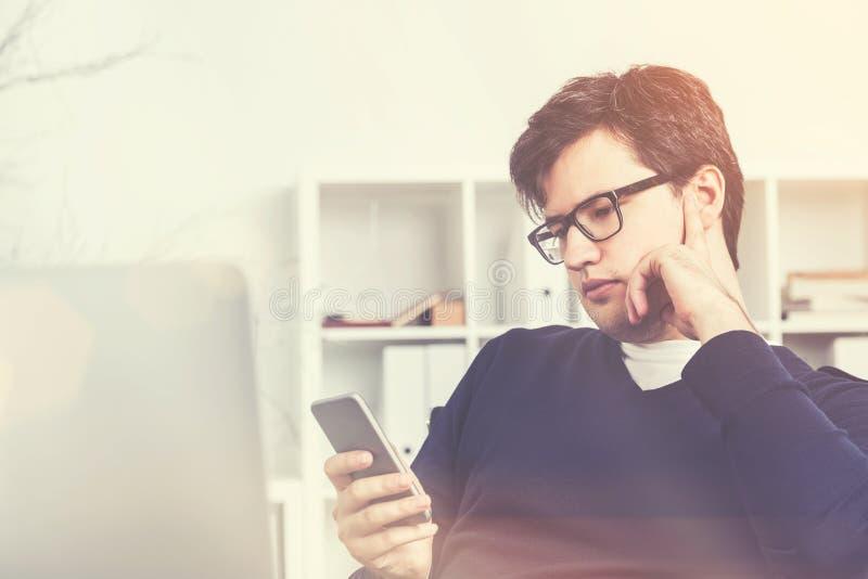 Businessman using his smartphone, toned stock photo
