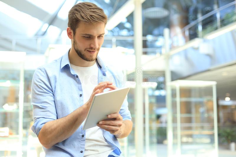 Businessman using his tablet in the office.  stock photos