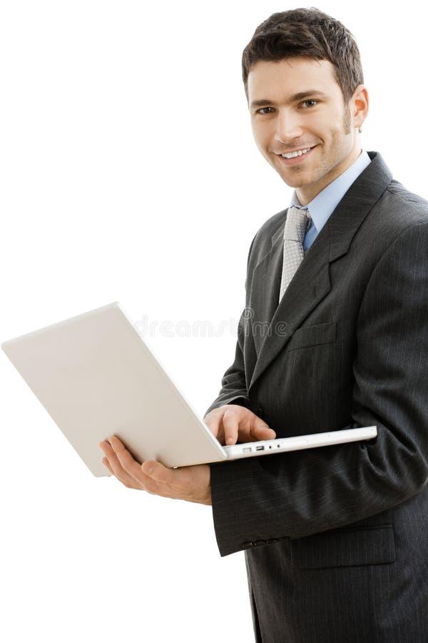 Businessman using laptop computer royalty free stock image