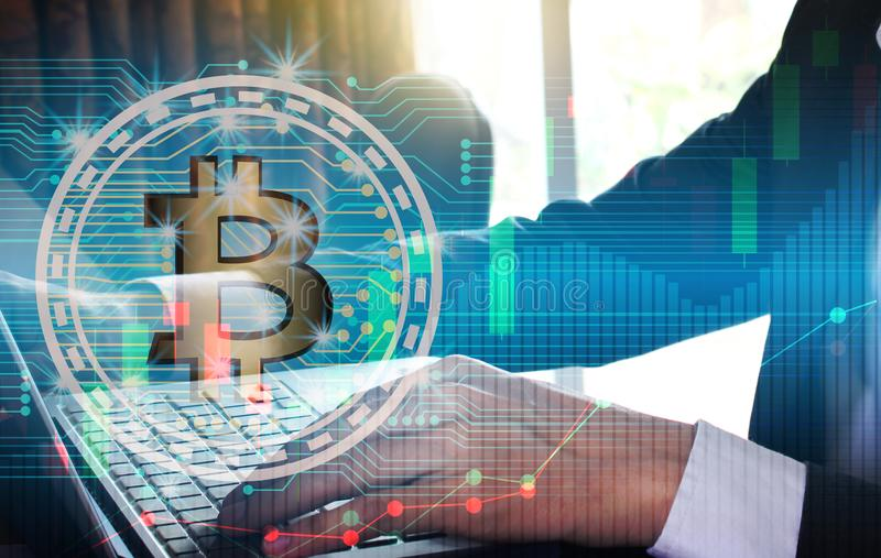 Businessman using the laptop. Double exposure of businessman using the laptop with bitcoin and blockchain network connection for financial investment concept royalty free stock photo