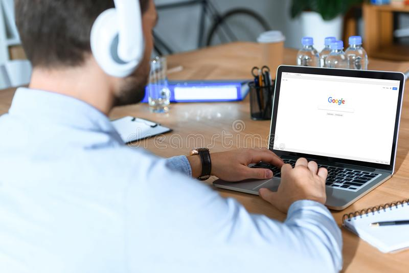 businessman using laptop with loaded royalty free stock photo