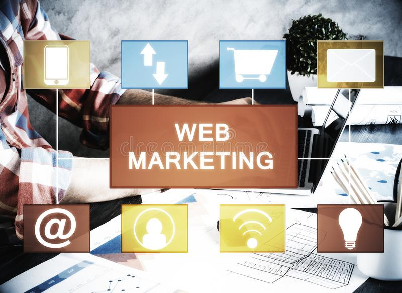Engineer with web marketing chart. Businessman using laptop at workplace with consturction blueprint and web marketing chart royalty free stock photography
