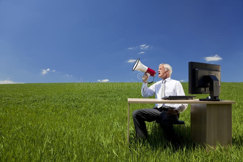 Download Businessman Using Megaphone In A Field Royalty Free Stock Photo - Image: 9717865