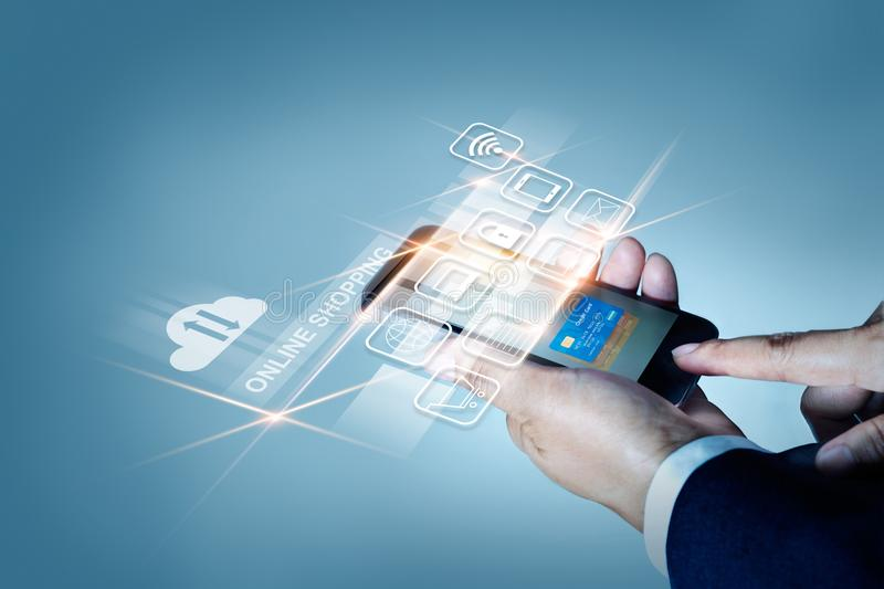 Businessman using mobile payments online shopping and icon customer network connection on screen, All on mobile screen are design. Up stock photo