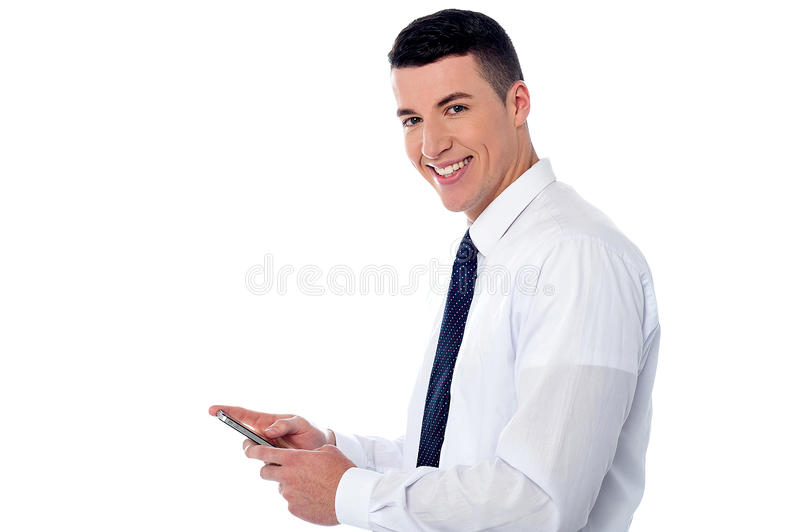 Businessman using mobile phone. Corporate guy sending message through mobile phone stock photos