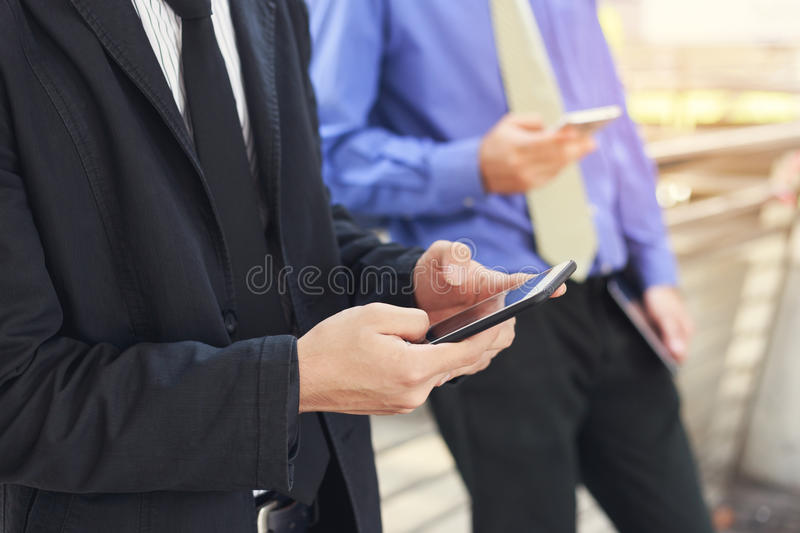 Businessman using mobile smart phone royalty free stock images