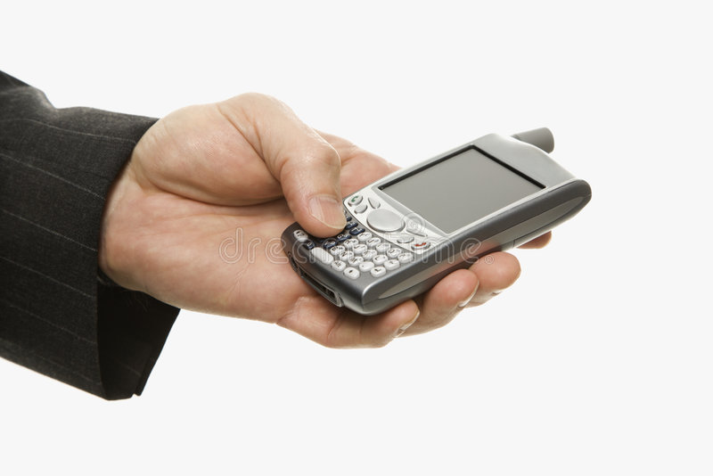 Businessman using PDA. Close-up of Caucasian middle-aged businessman using handheld PDA stock photos