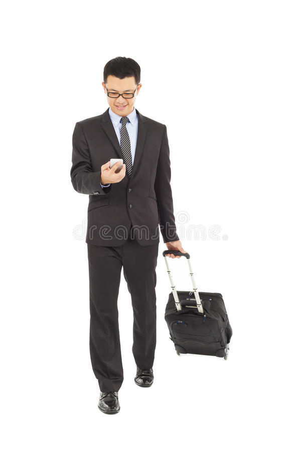 Businessman using phone  with briefcase