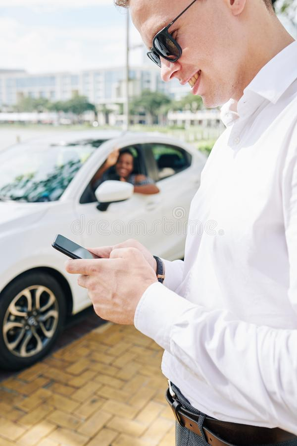 Businessman using phone in the city royalty free stock images