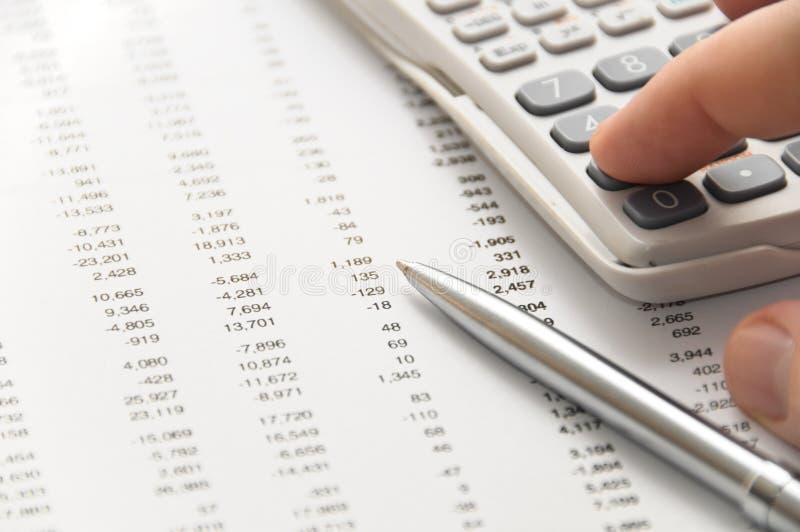 Businessman using scientific calculator stock photography