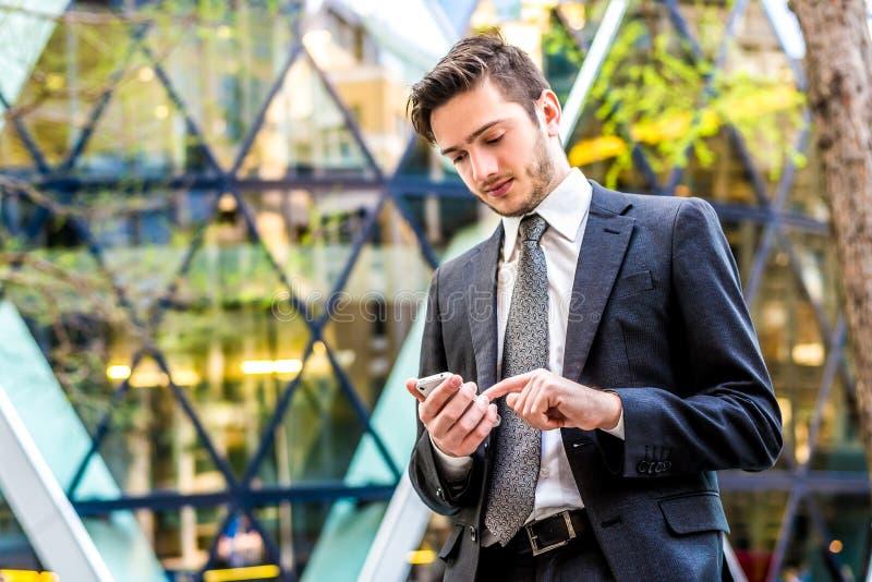 Businessman using smart phone royalty free stock photos