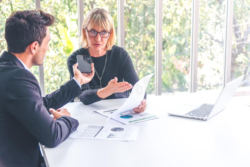 Businessman using a smartphone interview and recording business women talking about working project stock image