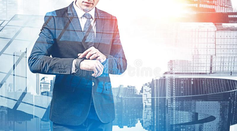Businessman using smartwatch in city royalty free stock images