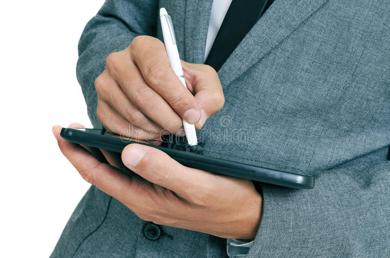 Businessman using a stylus pen in his tablet. Closeup of a businessman using a stylus pen in his tablet royalty free stock photography