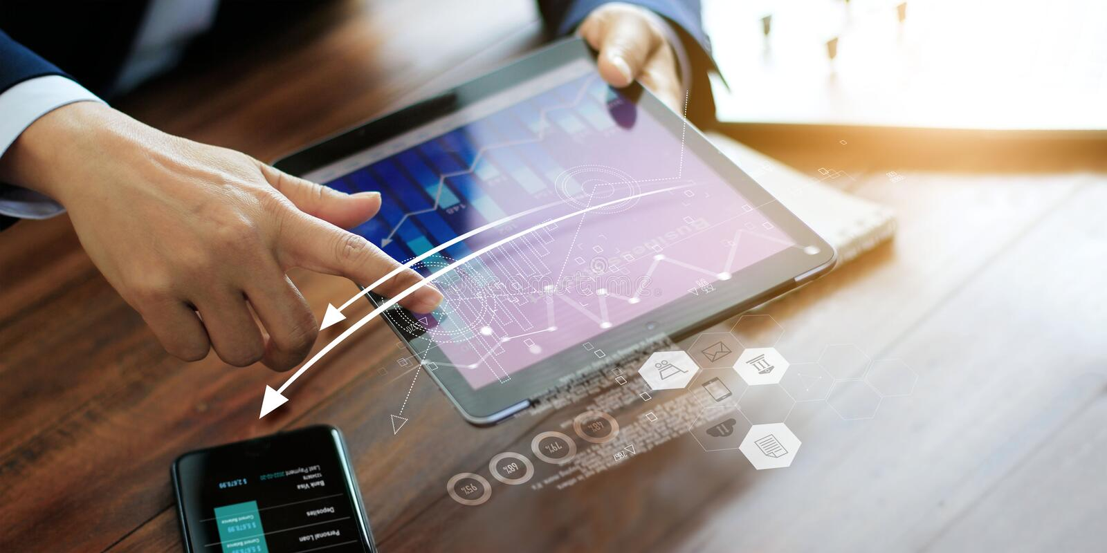 Businessman using tablet analyzing sales data and economic growth graph. Business planning and strategy. Digital marketing stock photo