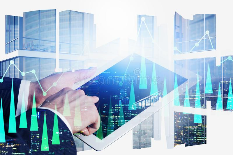 Businessman using tablet in city, digital chart stock photo