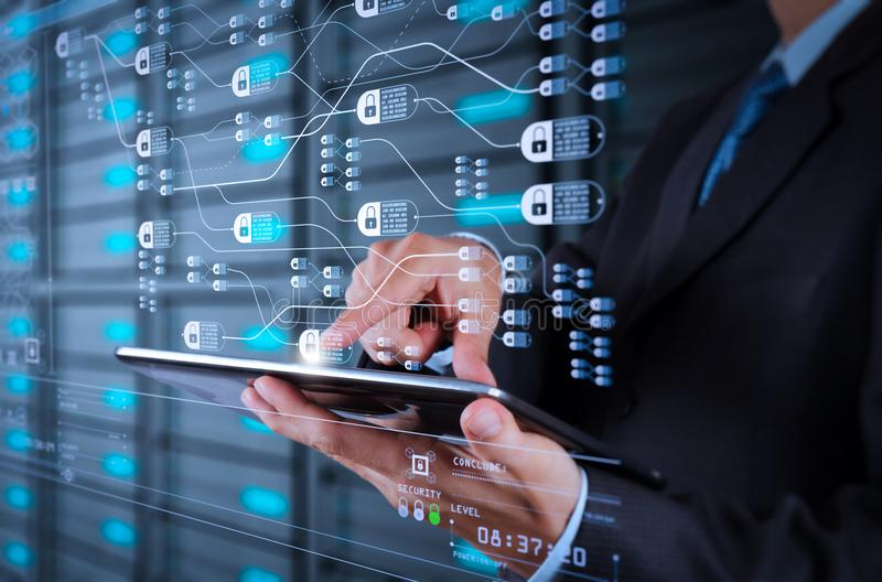 Businessman using tablet computer and server room background. Blockchain technology concept with diagram of chain and encrypted blocks.businessman hand using stock images