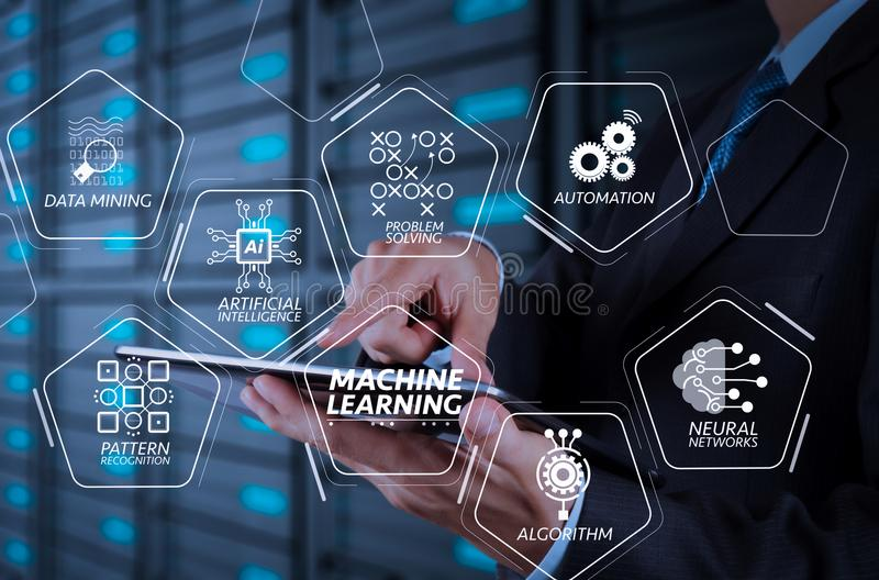 Businessman using tablet computer and server room background. Machine learning technology diagram with artificial intelligence (AI),neural network,automation royalty free stock photography