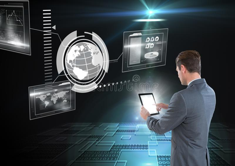 Businessman using tablet in a futuristic room and a world`s interface royalty free stock photos