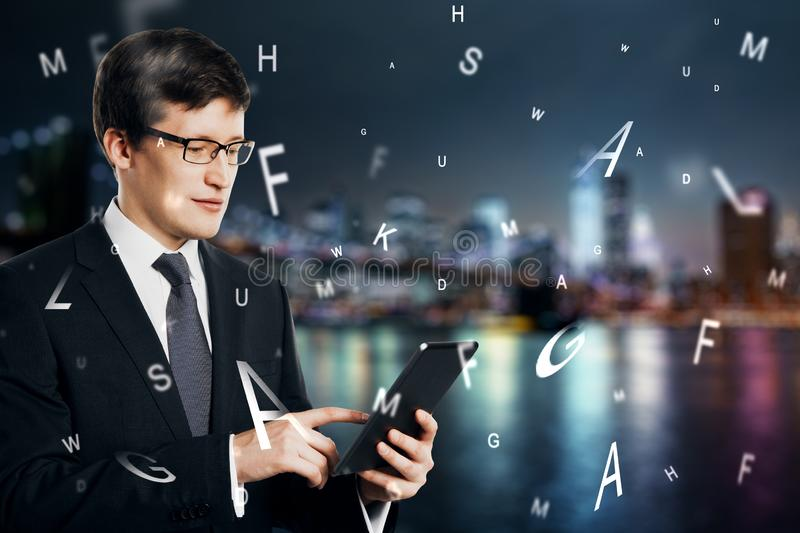Businessman using tablet with letters royalty free stock photo