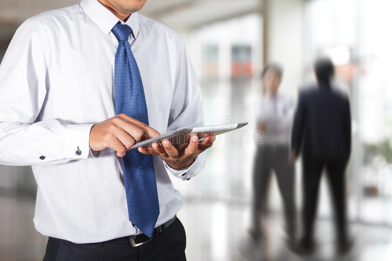 Businessman using tablet royalty free stock images