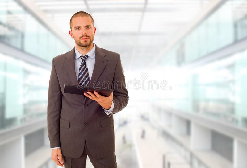 Tablet pc. Businessman using touch pad of tablet pc, at the office royalty free stock photo