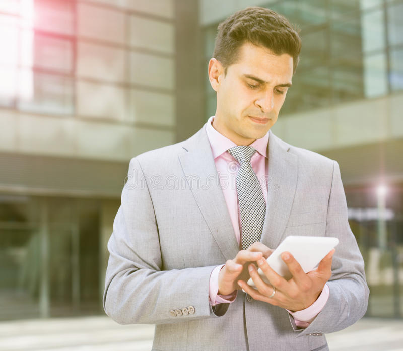 Businessman using touchscreen phone stock image