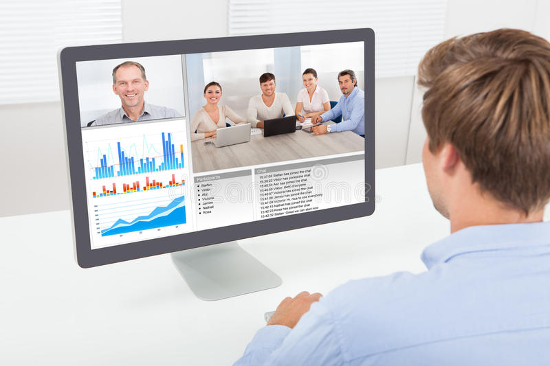 Businessman video conferencing on computer stock photography
