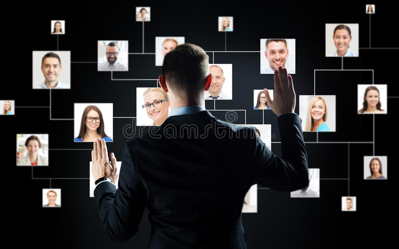 Businessman with virtual contact icons royalty free stock image