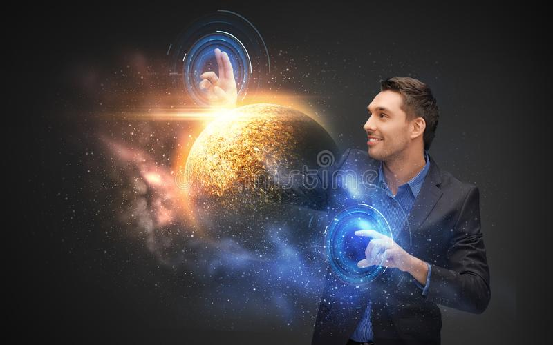 Businessman with virtual planet and space hologram. Business, future technology and augmented reality concept - businessman with virtual planet and space royalty free stock photography