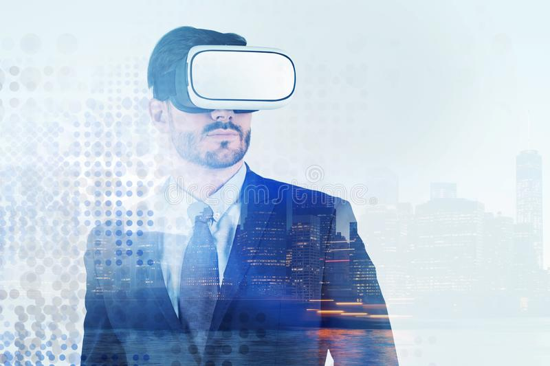 Businessman in vr glasses, night city royalty free stock photography