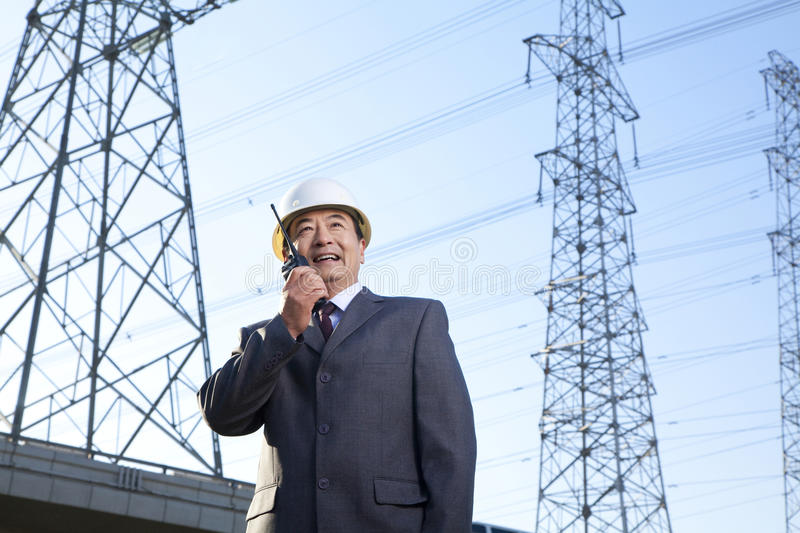 Businessman on Walkie Talkie royalty free stock photos
