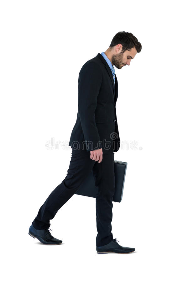 Businessman walking with briefcase royalty free stock photography