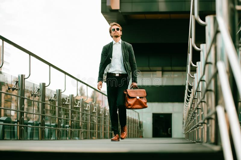 The Businessman Walking On the Business Center Bridge And Looking Around stock images
