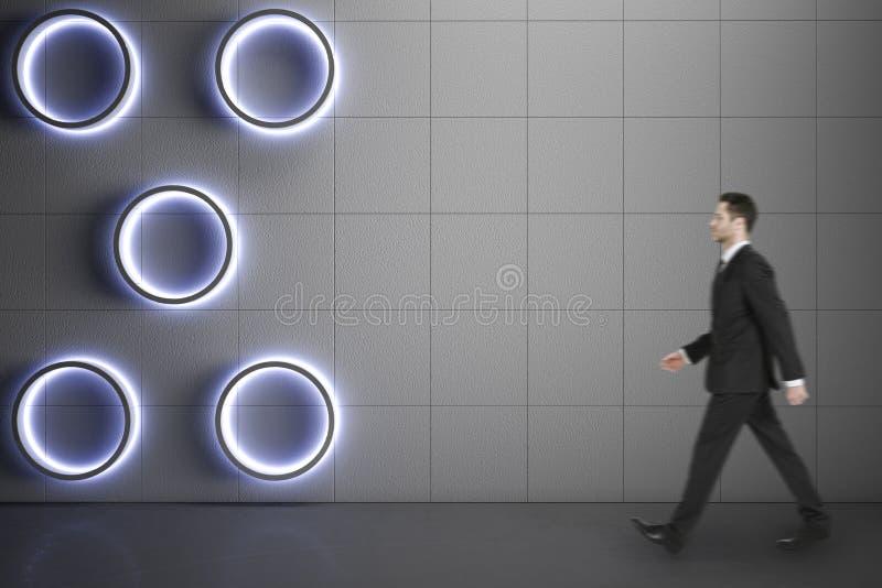 Businessman walking on concrete floor stock photo